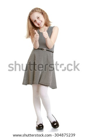 Adorable blonde girl in a gray summer , a lightweight silk dress is worth putting forward hands. The girl with both hands showing the sign of all good or OK-Isolated on white background - stock photo