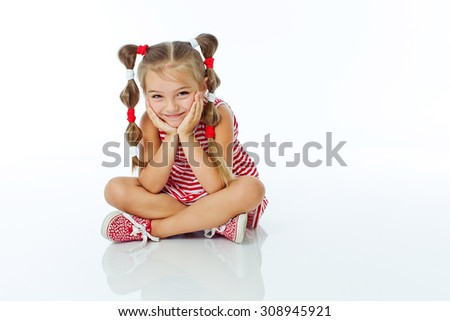 adorable blonde girl with pigtails smiles in studio, isolated on white - stock photo