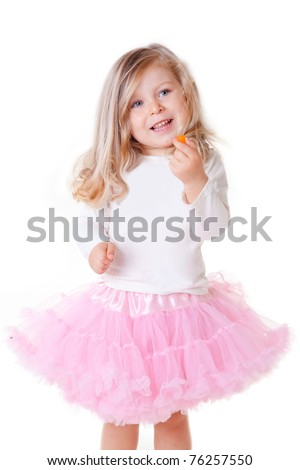 adorable blonde little girl holding a candy - stock photo