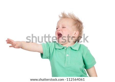 Adorable blue eyed blonde hair baby boy wearing green polo shirt, screaming and crying in temper tantrum - stock photo