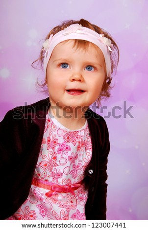 adorable blue eyes baby girl posing  on pink background - stock photo