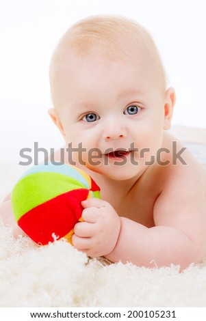 adorable boy age 6 months, play, emotions - stock photo