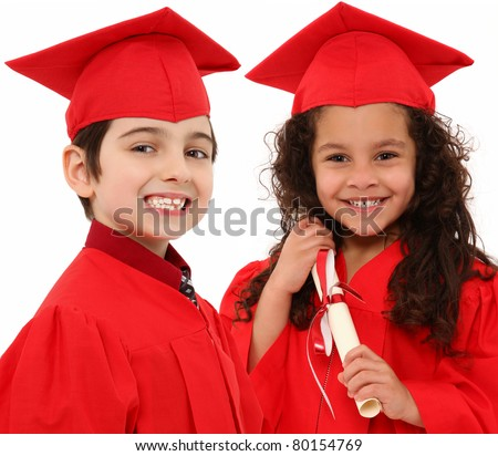Adorable boy and girl interracial graduation children with cap and gown and diploma over white.