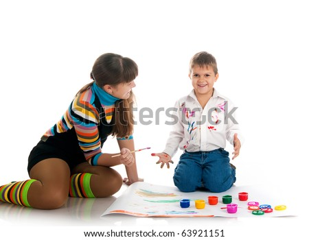 Adorable  boy and his mom covered in bright paint.