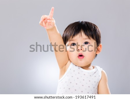 Adorable boy hand raised up