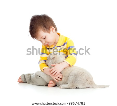 adorable boy hugging and playing with a puppy - stock photo