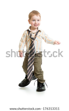 Adorable boy in big father's shoes isolated on white - stock photo