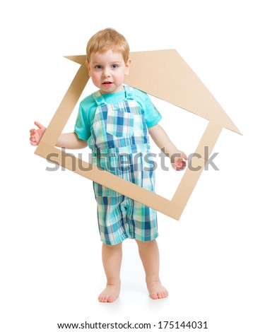 Adorable boy in own cardboard home or room concept - stock photo