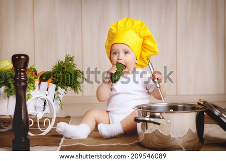 adorable boy   in the kitchen - stock photo