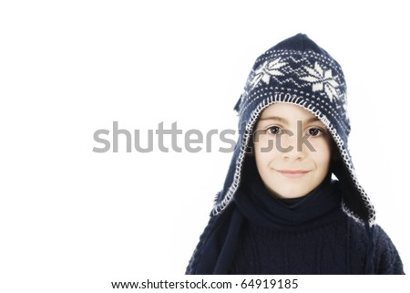 Adorable boy in winter clothes. Isolated on white