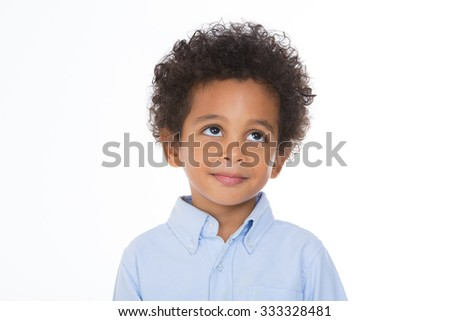 adorable boy looking to something with thoughtful expression - stock photo