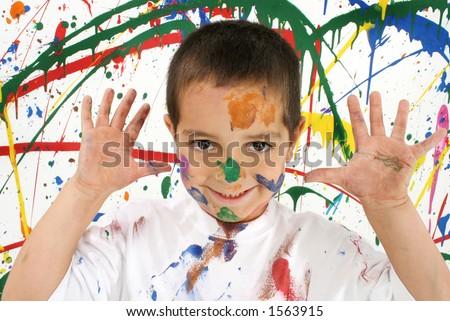 Adorable boy on splattered paint background - stock photo