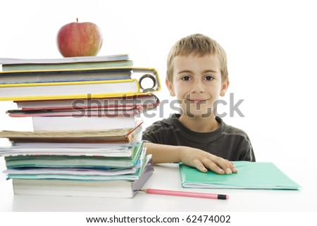 Adorable boy studying a over white background - stock photo