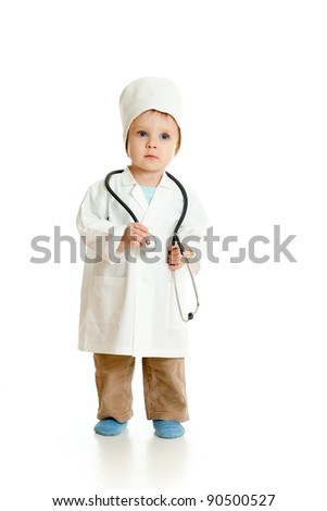 Adorable boy uniformed as doctor over white background - stock photo