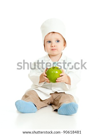 Adorable boy uniformed as doctor with healthy food over white - stock photo