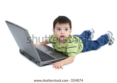 Adorable Boy With Laying On White Floor Working On Laptop.