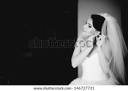 adorable brunette bride is getting ready in the morning - stock photo