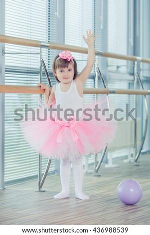 Adorable child dancing classical ballet in studio. - stock photo
