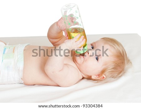 adorable child drinking from bottle. 6 months old girl. - stock photo