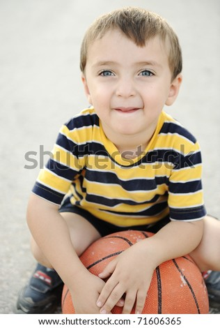 adorable child holding  the basketball