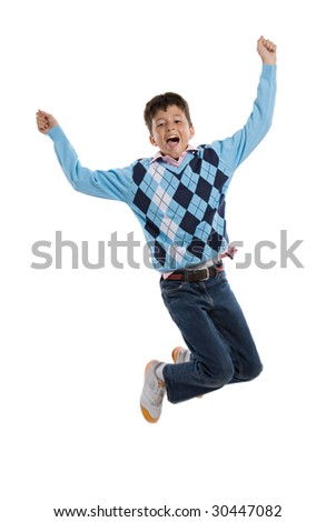 Adorable child jumping a over white background