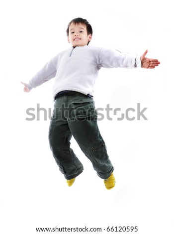 Adorable child jumping proudly a over white background - stock photo