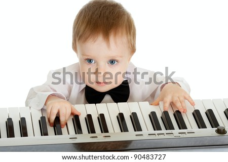 adorable child playing electric piano - stock photo
