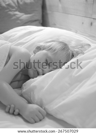 Adorable child sleeping soundly                                         - stock photo