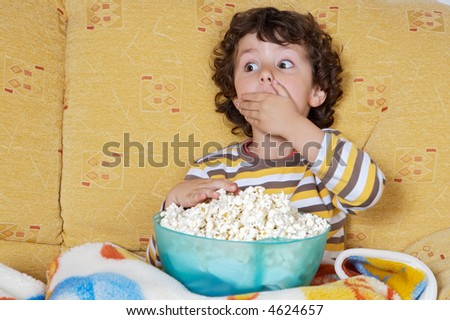 adorable child Watching TV in his home - stock photo