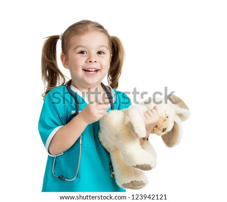 Adorable child with clothes of doctor injecting plush toy over white