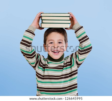 Adorable child with many books on the head isolated over blue background - stock photo