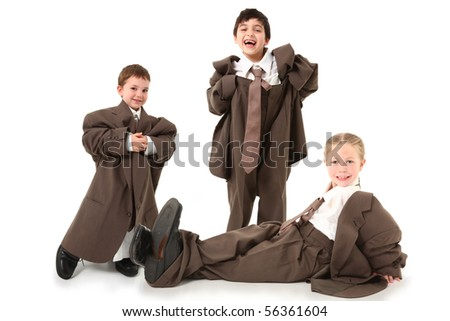 Adorable children in baggy business suits over white. - stock photo