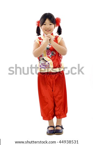 Adorable Chinese little girl wishing you  a happy and prosperous Chinese New year!   Gong Xi Fa Cai !  Isolated over white - stock photo