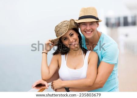 adorable couple enjoying a cruise vacation - stock photo