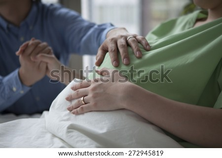 Adorable couple in a hospital room - stock photo