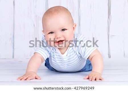 Adorable crawling baby - stock photo