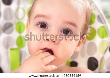 Adorable cute baby eating with hands close up - stock photo