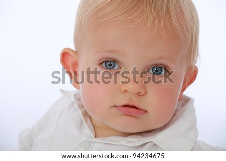 Adorable cute baby face pulling funny faces smiling - stock photo
