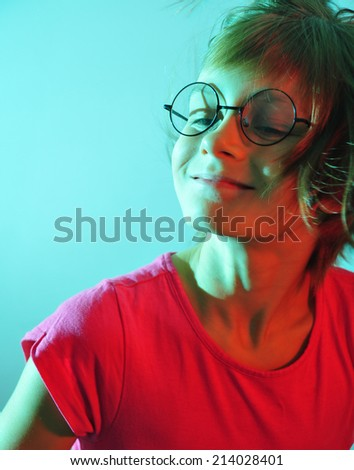 adorable cute happy smiling child lit with color light - stock photo