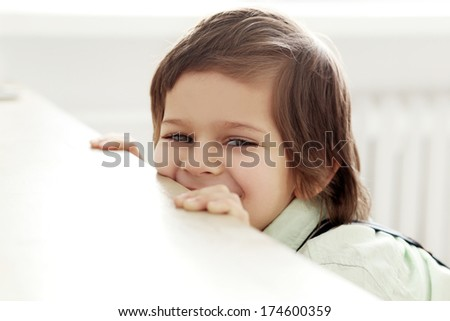 Adorable, cute kid in a white shirt - stock photo