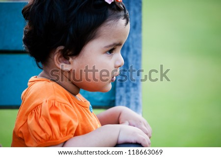 Adorable cute little baby girl in a park - stock photo