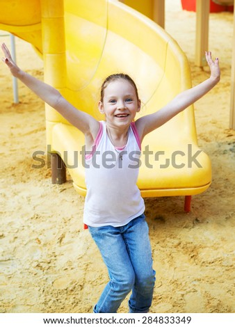Adorable cute pretty little girl playing outdoors in summer. Happy childhood. - stock photo