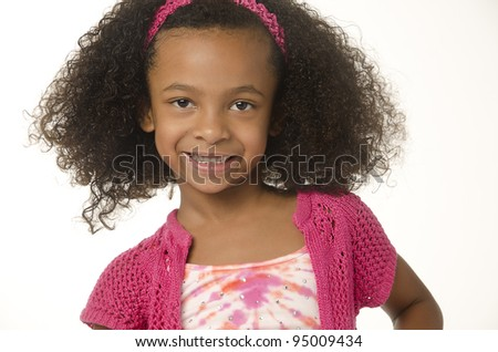 Adorable cute smiling little girl with curly hair.  Image isolated against white background. - stock photo