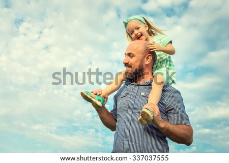 Adorable daughter and father portrait, happy family, future concept - stock photo