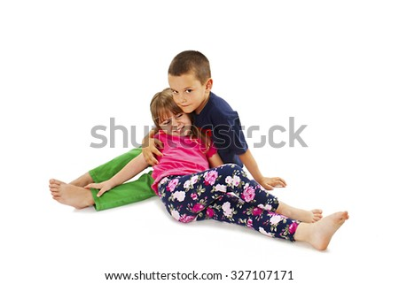 Adorable family. Sister and brother. Isolated on a white background   - stock photo