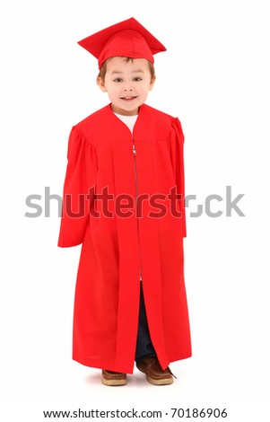 Adorable four year old boy in red graduation cap and gown smiling over white background. - stock photo