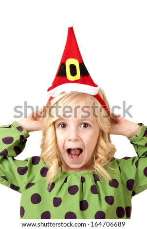 adorable fun blond girl wearing santa hat - stock photo
