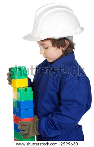 adorable future builder constructing a brick wall with toy pieces a over white background - stock photo