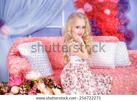 Adorable girl among the flowers - stock photo