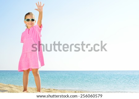 Adorable girl dancing on the beach - stock photo